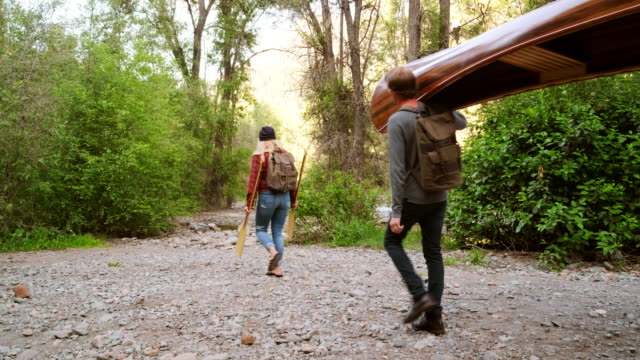 young adults with a canoe in the wilderness - canoe stock videos & royalty-free footage