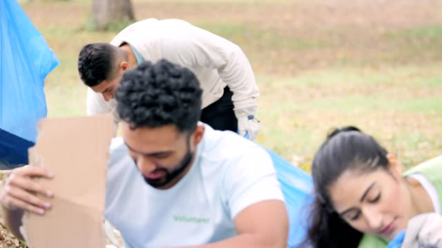 Young adults work with their neighbors to clean up their community