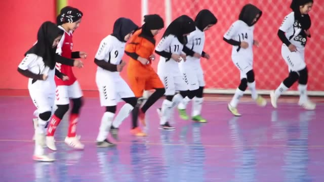 young afghan female players take part in a futsal tournament match in kabul, afghanistan on january 08, 2017. eight teams with female members are... - kabul stock videos & royalty-free footage