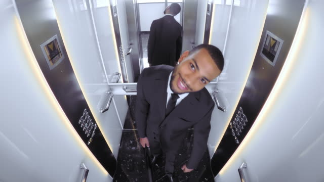 pov young african american business man entering elevator - elevator point of view stock videos and b-roll footage
