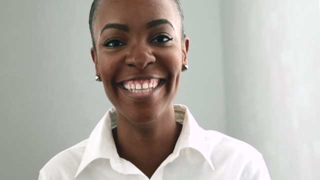 Young African American business woman smiling and head back laughter to camera