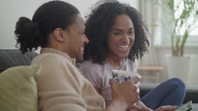 young african american couple at home - minoranza video stock e b–roll