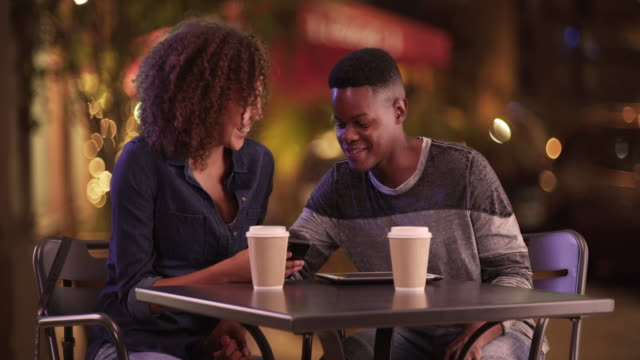 young african american couple have coffee at night in the city - coffee drink stock videos & royalty-free footage