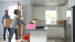 Young African American couple moving in to a new home