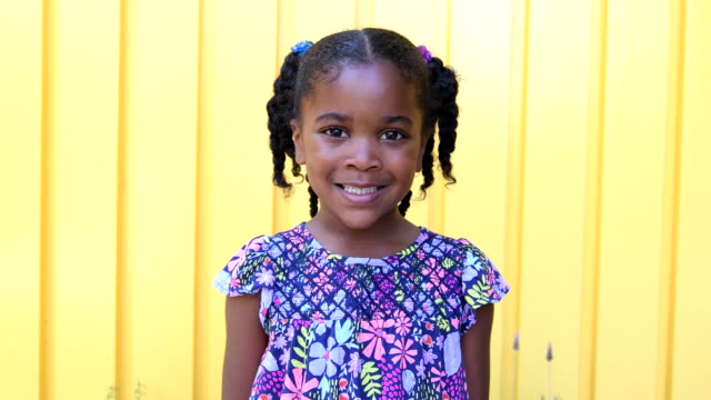 young african american girl smiling and looking serious - one girl only stock videos & royalty-free footage