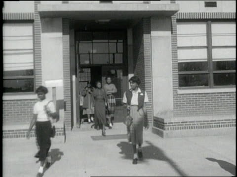 young african american girls exit a high school building - jim crow laws stock videos & royalty-free footage