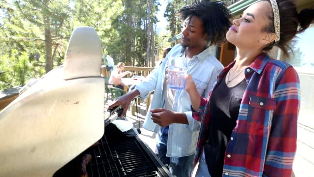 young african american man and woman grill outdoors while on vacation - carefree stock videos & royalty-free footage