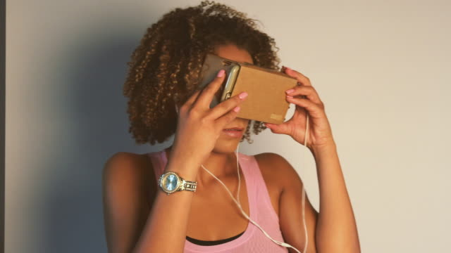 Young African American Woman Using Virtual Reality Device