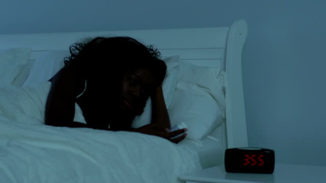 Young African American women in bed