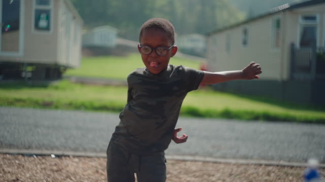 young African boy dancing outdoors