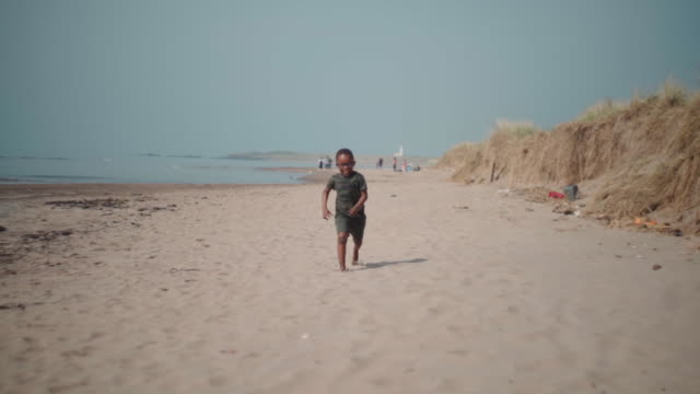 young african boy running and laughing