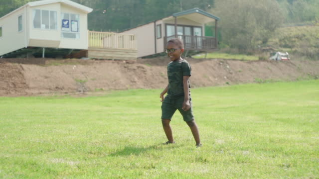 young african boy running on grass