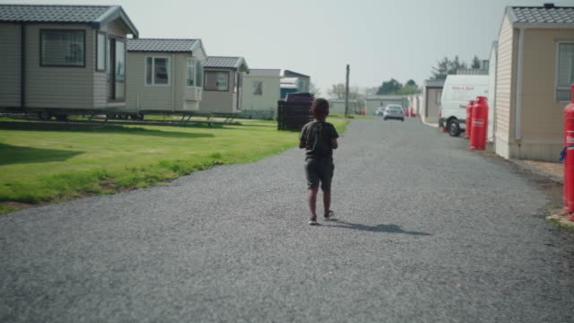 young african boy walking alone