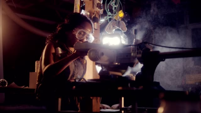 young african ethnicity woman working in wood workshop - potere femminile video stock e b–roll