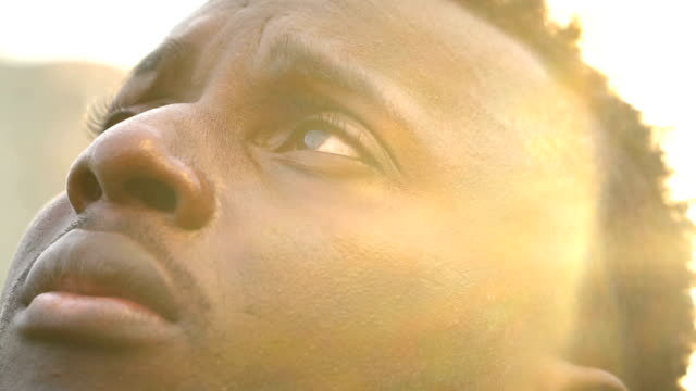 young african man looking to the sky - slow-motion stock videos & royalty-free footage