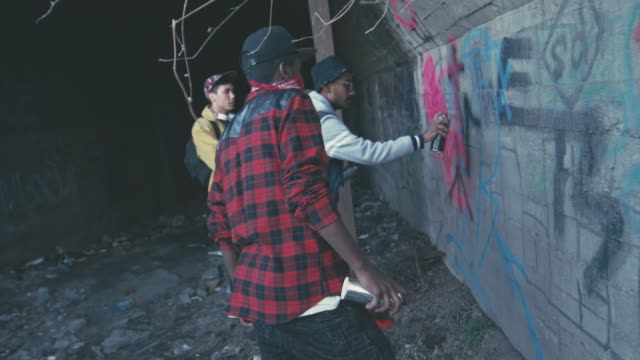 young african men drawing graffiti - beer cap stock videos & royalty-free footage
