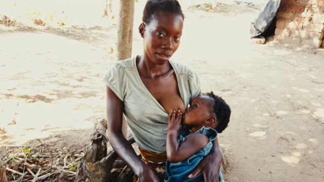young african woman breastfeeding the baby - breastfeeding stock videos & royalty-free footage