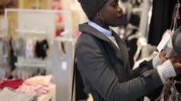 Young African woman browsing in the fashion store