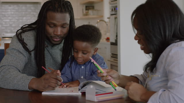 Young African-American Family Coloring Together