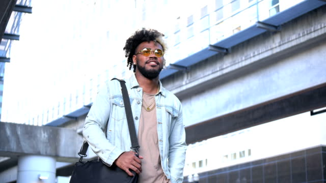 young african-american man in the city - denim jacket stock videos & royalty-free footage