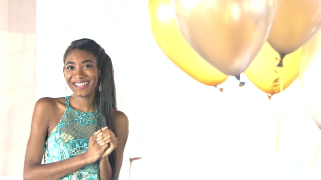 Young African-American teenage girl wearing prom dress