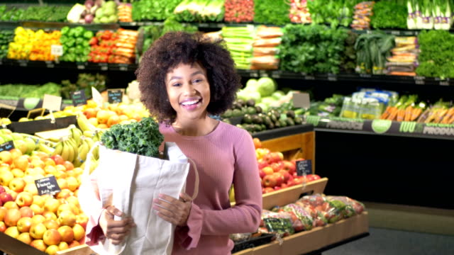 young african-american with reusable bag in supermarket - reusable bag stock videos & royalty-free footage