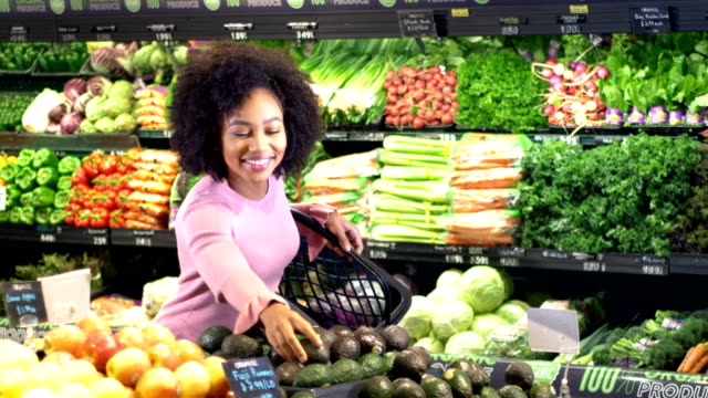 young african-american woman buying groceries - shopping basket stock videos and b-roll footage