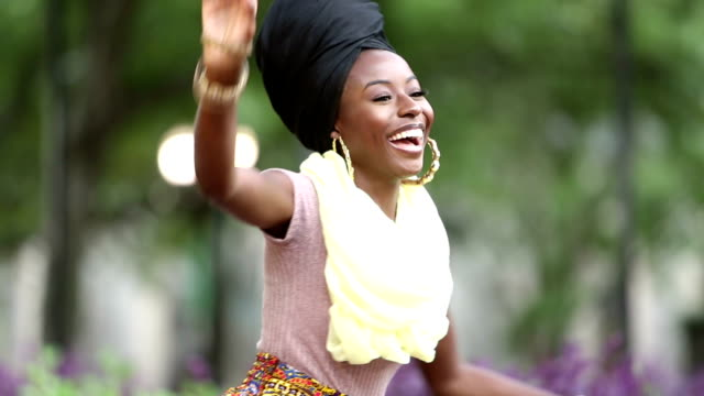 young african-american woman dancing - orecchini video stock e b–roll