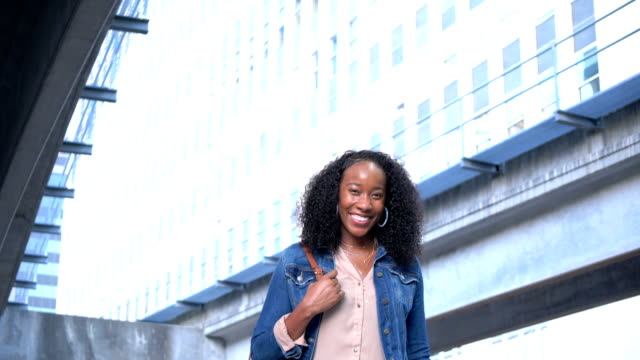 young african-american woman in city, smiling - denim jacket stock videos & royalty-free footage