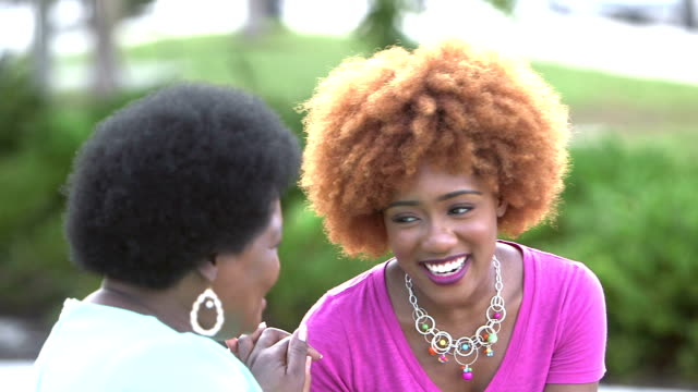 Young African-American woman laughing with her mother