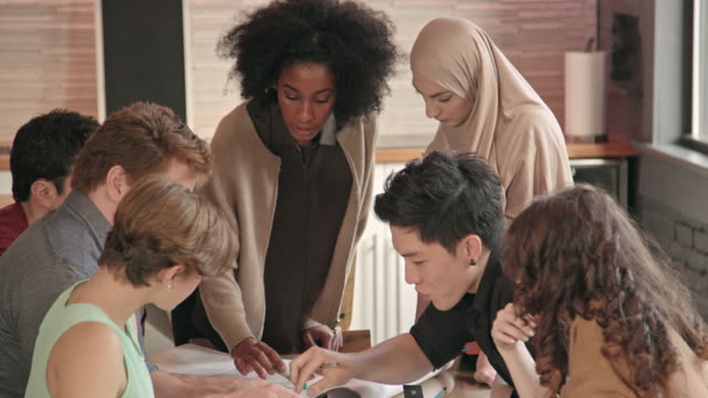 young african-american woman leads multi-ethnic team meeting cu - hijab stock videos & royalty-free footage