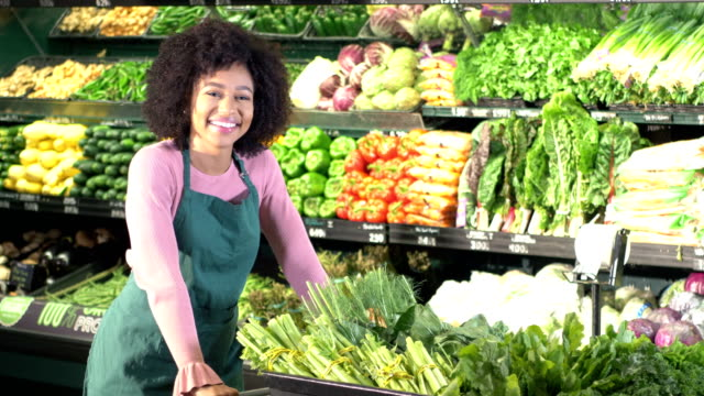 young african-american woman working in supermarket - market retail space stock videos and b-roll footage