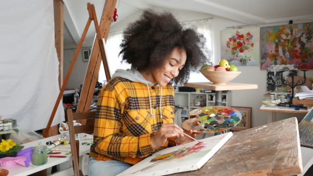 young afro woman drawing - paintings stock videos & royalty-free footage