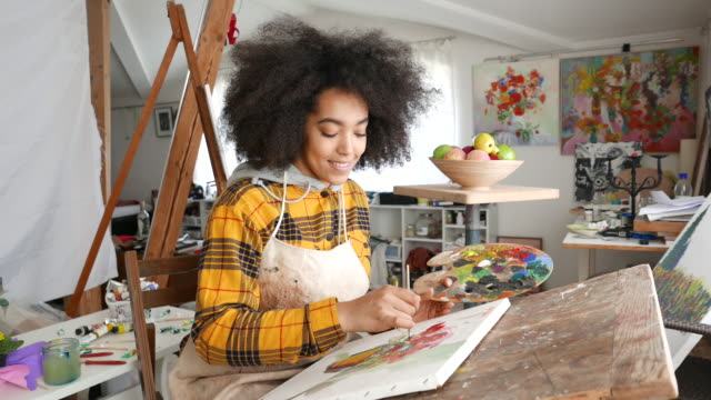 young afro woman drawing - hobbies stock videos & royalty-free footage