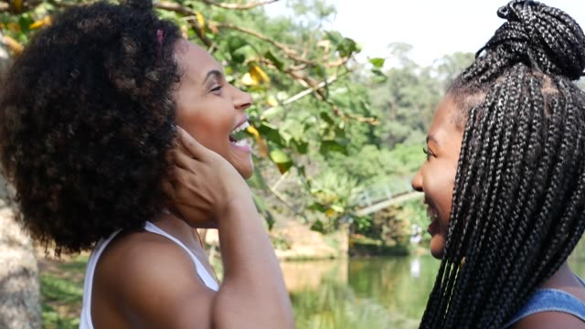 young afro woman listing to music and dancing in the park - dreadlocks stock videos & royalty-free footage