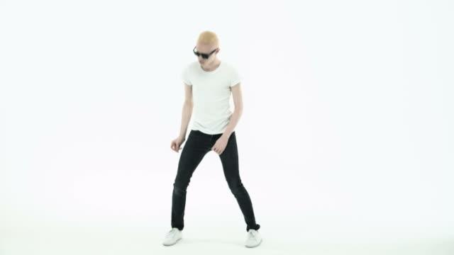 Young albino man dancing
