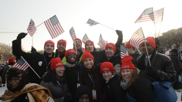 stockvideo's en b-roll-footage met young americans waving flags and posing for photos are excited and enthusiastic in support of president barack obama's inauguration at the national... - 2013