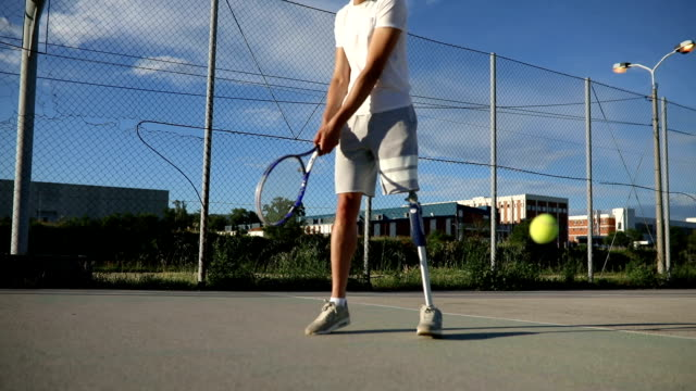 young amputee playing tennis - artificial limb stock videos & royalty-free footage