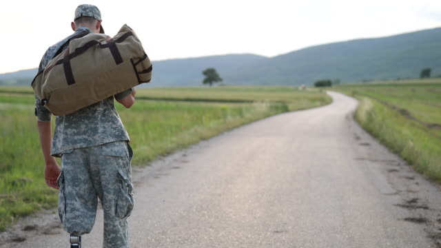 young amputee soldier coming home - war veteran stock videos & royalty-free footage