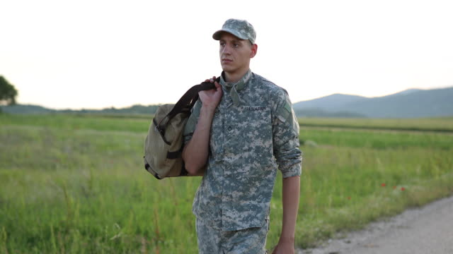 young amputee soldier coming home - disability services stock videos & royalty-free footage