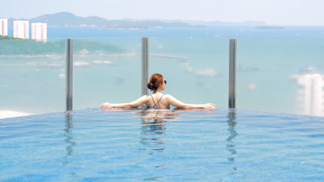 young and beautiful girl in the pool - infinity pool stock videos & royalty-free footage