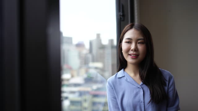 young and beautiful taiwanese woman - looking through window stock videos & royalty-free footage
