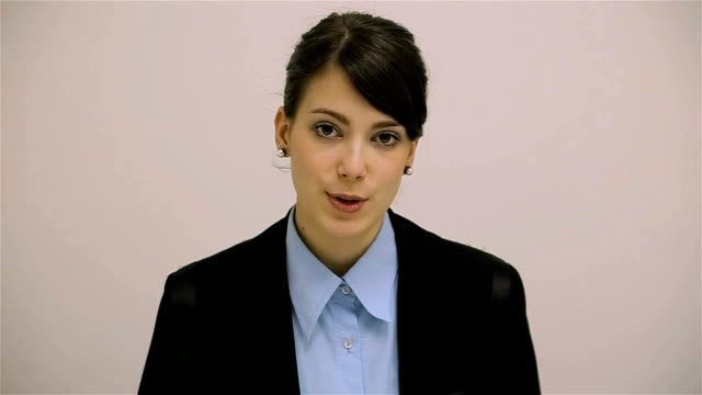 Young and beautiful woman looking at camera and talking,television host