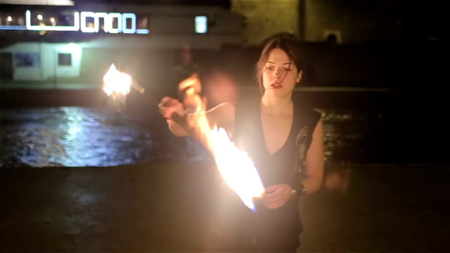 young and beauty lady with fire