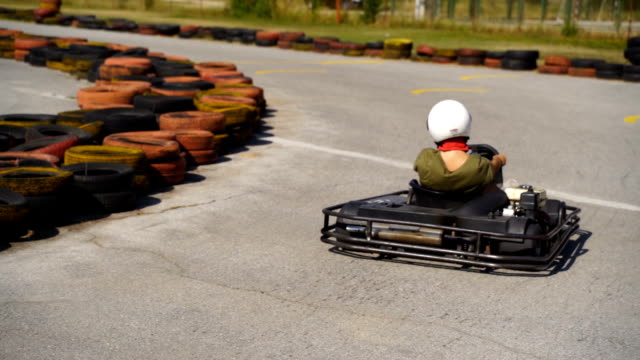 young and brave 13 years old girl driving go-cart - sports helmet stock videos & royalty-free footage