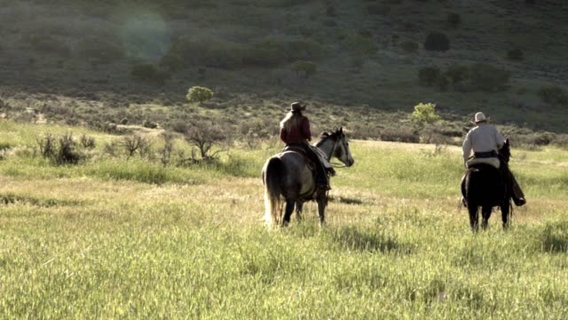 young and old cowboy duo riding the range - horse blanket stock videos & royalty-free footage