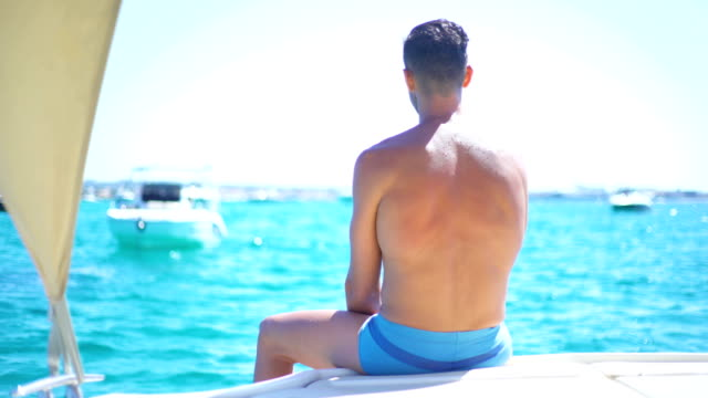 young and strong man relaxed in yatch - men's underpants stock videos and b-roll footage