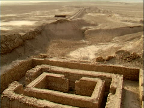 young arab boy standing at site of ancient city of uruk iraq - old ruin stock videos & royalty-free footage