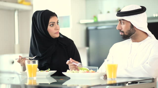 young arab couple eating heatlhy food at home - islam stock videos & royalty-free footage