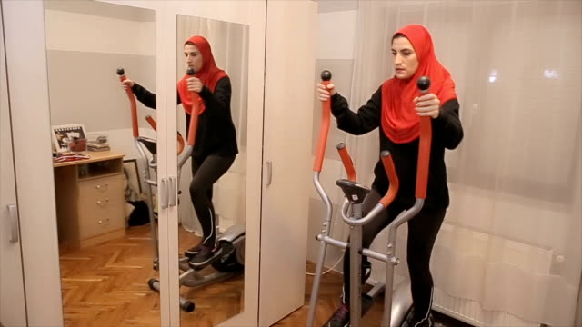 young arab woman exercise at home - islam stock videos & royalty-free footage
